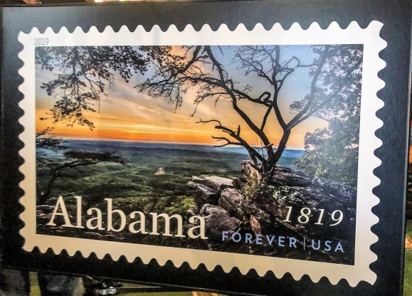 A large mounted image of the Alabama Statehood Forever Stamp on display at its unveiling in Huntsville. (contributed)
