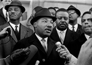 Civil rights leaders Martin Luther King Jr.(foreground), Fred Shuttlesworth (left) and Ralph Abernathy (right) attend a voter-registration drive at the Dallas County Courthouse in Selma in January 1965. (From Encyclopedia of Alabama, courtesy of The Birmingham News)