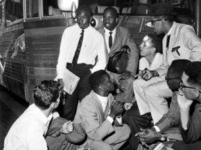 The Rev. Fred Shuttlesworth, crouching center, and Freedom Riders discuss plans at the Birmingham Greyhound Terminal after drivers refused them service. Freedom Riders are, clockwise from left: Ed Blankenheim (kneeling), Charles Person, Theodore Gaffney, James Peck, the Rev. Benjamin Cox, Moses Newson and Simeon Booker. (From Encyclopedia of Alabama, courtesy of The Birmingham News)