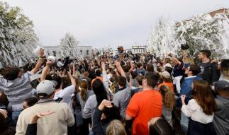 Auburn fans celebrate at Toomer's Corner after the men's basketball team beat Kentucky to earn a spot in the NCAA Final Four. (Todd Van Emst/AU Athletics)
