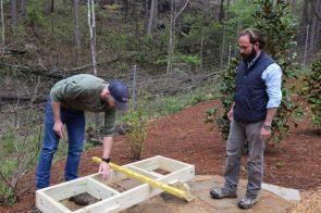Hickman and Daniel McCurry check measurements. (Donna Cope/Alabama NewsCenter)