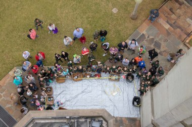 Students watch to see if an egg survives a 100-plus-foot fall inside an apparatus built for this year's egg drop contest organized by the University of Alabama at Birmingham School of Engineering. (Dennis Washington/Alabama NewsCenter)