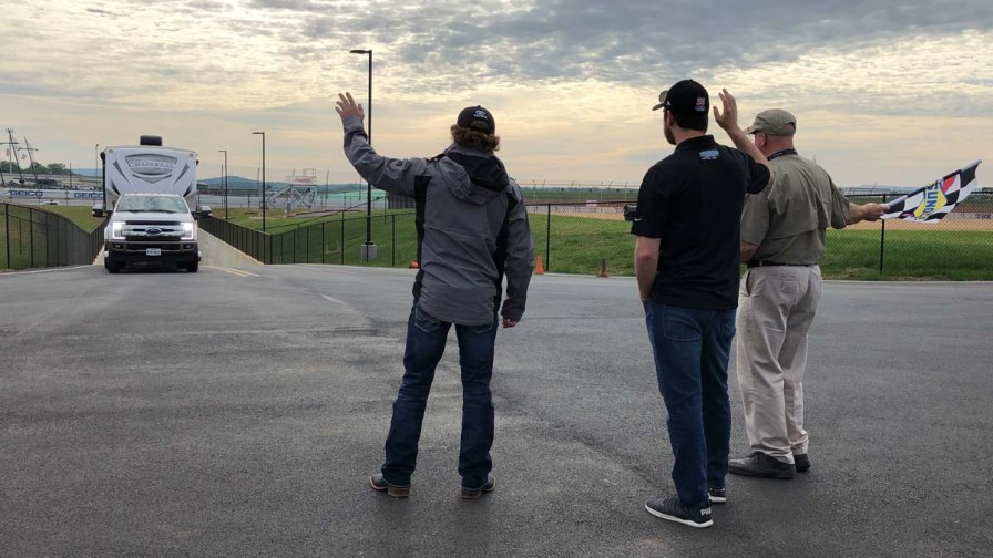 NASCAR drivers Jeffrey Earnhardt (left) and Chase Briscoe (center) joined Talladega Superspeedway Chairman Grant Lynch (right) to welcome fans as they entered the infield via the new oversized tunnel. (Dennis Washington / Alabama NewsCenter)