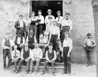 Workers posing in front of the Shelby Iron Company commissary. (From Encyclopedia of Alabama)