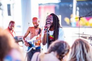 Jesse Royal performs at the 2019 Hangout Music Festival. (Nik Layman / Alabama NewsCenter)