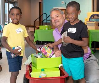 Volunteers from Alabama Power Service Organization, Regions, Greystone Golf and Country Club and Edgar's Bakery teamed with Cheeriodicals to pack and deliver gift boxes to mothers and children at Children's of Alabama on Mother's Day. (Children's of Alabama)