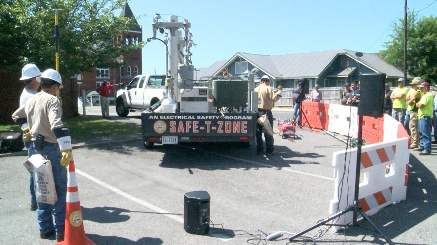 An Alabama Power Safe-T-Zone crew demonstrates the dangers and safe approaches to power lines for first responders. (Dennis Washington/Alabama NewsCenter)