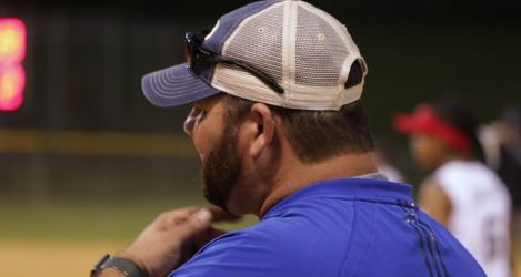 Heith Hase has three daughters and spends a lot of time coaching softball. (Joe Allen/Alabama NewsCenter)