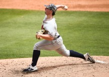 Tanner Burns (32) pitches in Auburn's win over North Carolina. (Cat Wofford/Auburn Athletics)