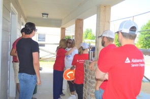 Vickie Edwards greets the Habitat for Humanity volunteers working on her house. (Danielle Kimbrough)