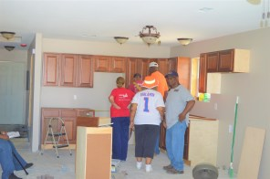 Sam and Vickie Edwards check out their future kitchen with Habitat volunteers. (Danielle Kimbrough)