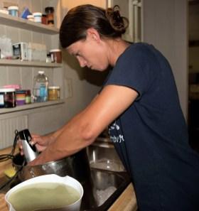Amber Bennett puts together a batch of Forgotten Ways Farm goat milk soap. (Brittany Faush / Alabama NewsCenter)