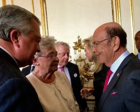 Gov. Kay Ivey and Commerce Secretary Greg Canfield speak with Wilbur Ross, secretary of the U.S. Department of Commerce, in Paris during the air show mission. (Bob Smith)