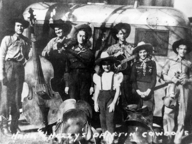 Hank and Hezzy's Driftin' Cowboys, from left: Smith Adair, Braxton Schuffert, Irene Williams, unknown, Hank Williams, Carolyn Parker and Freddie Beach. (From Encyclopedia of Alabama, courtesy of Alabama Department of Archives and History)