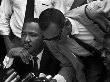On May 10, 1963, ministers Martin Luther King Jr., left, and Wyatt Tee Walker, right, announced an agreement with Birmingham businesses to desegregate certain services and jobs in the city. (From Encyclopedia of Alabama, courtesy of The Birmingham News, photograph by Tom Self)