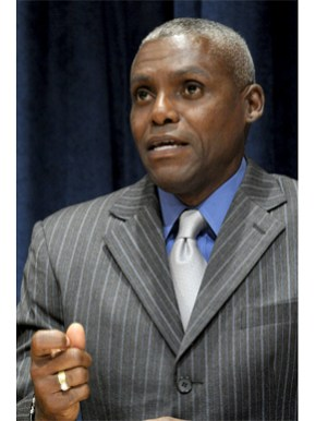Former track and field star Carl Lewis, a United Nations Food and Agriculture Organization goodwill ambassador, speaks during an event honoring the winners of the U.N. Future Policy Awards at U.N. headquarters in New York City in September 2011. (From Encyclopedia of Alabama, photograph by Evan Schneider, courtesy of the United Nations)