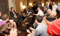 Auburn coach Gus Malzahn talks to the local beat reporters at SEC Media Days. (Todd Van Emst/AU Athletics)