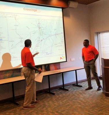 Alabama Power's K-Rob Thomas and T.J. Pruitt talk with incoming Auburn University freshmen about engineering. (Tyus Underwood/Alabama NewsCenter)