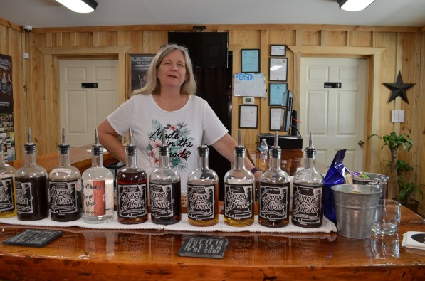 Co-owner Kay Keel is the head taster and handles sales in Gibson Distilling's tasting room. (Michael Tomberlin/Alabama NewsCenter)