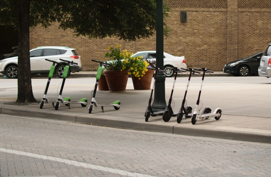 Dockless electric scooters on the sidewalk in San Antonio. At least 10 Alabama cities are looking at allowing e-scooters after the state government gave them the OK. (Getty Images)
