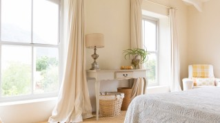 Light-colored drapes help repel the harsh summer sun rays. (Getty Images)