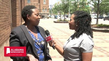 Marie Sutton speaks with Keisa Sharpe-Jefferson outside the Birmingham Civil Rights Institute. (Dennis Washington / Alabama NewsCenter)