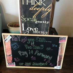 Encouraging sayings abound at WE Cafe and reminders that patrons can pay as they can. (Keisa Sharpe)