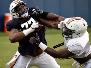 Marquel Harrell and Nick Coe square off during a full-pads practice. (Todd Van Emst/AU Athletics)