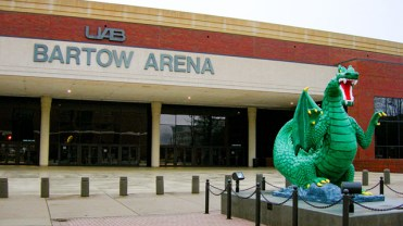 Bartow Arena on the UAB campus is home to the UAB Blazers, an NCAA Division I men's basketball program founded in the late 1970s. The arena is named for UAB's first men's basketball coach, Gene Bartow. At right is a statue of Blaze, the UAB team mascot. (From Encyclopedia of Alabama, photograph by Jimmy Emerson)