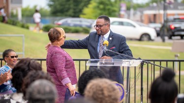 Bobbie Knight, left, and previous Miles College President George T. French Jr. embrace during a news conference in August at which Miles College officially announced Knight would serve as the school's interim president following French's resignation. (Dennis Washington / Alabama NewsCenter)