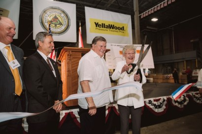 Gov. Kay Ivey joins Jimmy Rane and officials in cutting the ribbon on the new Abbeville Fiber sawmill. (contributed)