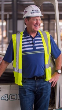 Rusty Wallace poses for pictures inside the new Open Air Club. (Dennis Washington / Alabama NewsCenter)