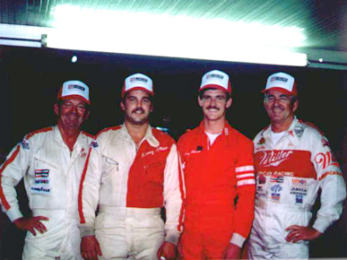 """Allison family NASCAR personalities, from left: father and son Donnie and Kenny Allison, and son and father Davey and Bobby Allison. Brothers Donnie and Bobby Allison, along with Charles """"Red"""" Farmer, formed the core of the Alabama Gang of successful NASCAR drivers based out of Hueytown, Jefferson County. (From Encyclopedia of Alabama, courtesy of Bobby Allison Racing, Inc.)"""