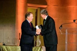 U.S. Sen. Doug Jones of Alabama, left, shakes hands with Zeke Smith, executive vice president of Alabama Power, at the Alliance to Save Energy awards ceremony. (contributed)
