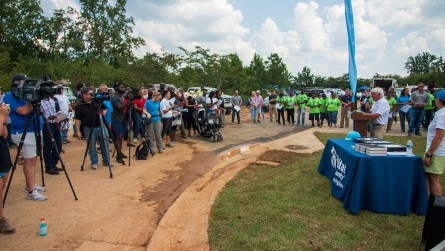 Thursday, all of the homeowners, builders and volunteers gathered for a key presentation ceremony at the conclusion of the Home Builders Blitz. (Dennis Washington / Alabama NewsCenter)