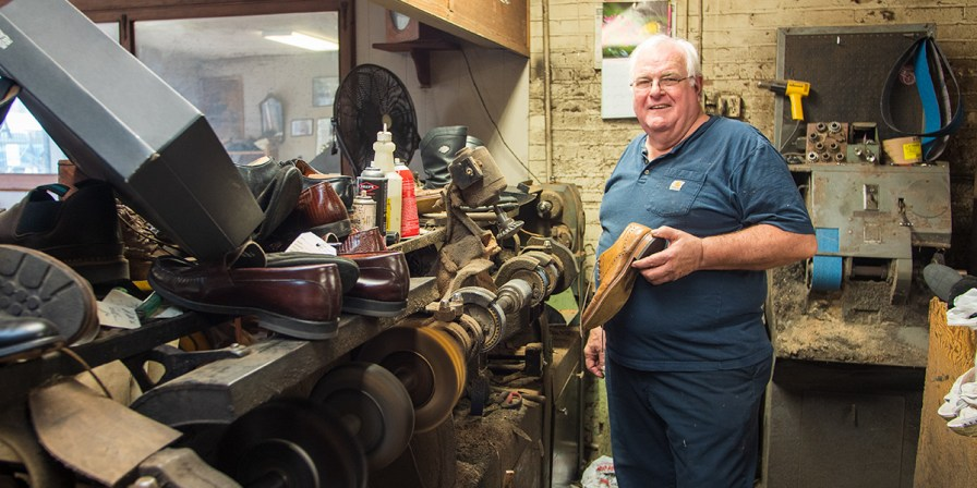 Brand Leege has been working at Dauphine Shoeteria for 51 years. (Dennis Washington / Alabama NewsCenter)