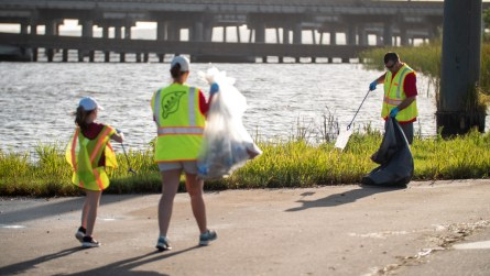 Employees of Alabama Power, along with their families, volunteer their time to help pick up trash during the 2019 Alabama Coastal Cleanup. (Dennis Washington/Alabama NewsCenter)