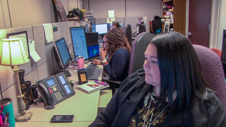 Julie McCormick, foreground, works to improve the customer experience with Alabama Power. (Dennis Washington/Alabama NewsCenter)