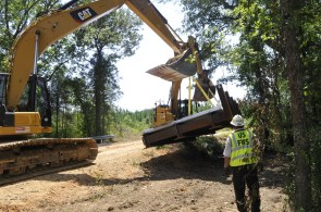 A bridge is lowered next to the culverts it will replace on St. Clair County's Little Canoe Creek. (Karim Shamsi-Basha/Alabama NewsCenter)
