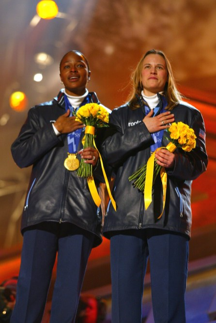 Vonetta Flowers and Jill Bakken of the USA receive their gold medals in the 2-woman bobsleigh at the medal awards ceremony at the Olympic Medals Plaza during the Salt Lake City Winter Olympic Games in Salt Lake City, Utah. (Clive Mason/Getty Images)