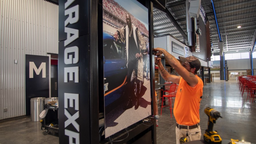 Crews put the final touches on the new Talladega Garage Experience. (Dennis Washington / Alabama NewsCenter)