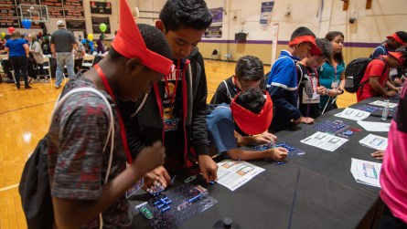 Students learn how to build a circuit during this hands-on demonstration. (Dennis Washington / Alabama NewsCenter)