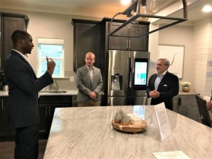 Southern Company Research and Development's Olu Ajala, left, and Jim Leverette, center, brief Deputy Energy Secretary Dan Brouillette on Alabama Power's Smart Home and Reynolds Landing Smart Neighborhood. (Michael Sznajderman / Alabama NewsCenter)