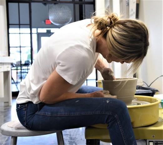 A team of artisans produce pottery at Susan Gordon Pottery. (Brittany Faush / Alabama NewsCenter)