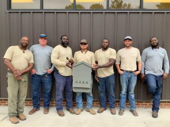 Alabama Power volunteers, from left, Antonio Thornton, Brian Link, Chris Jackson, Robert York, Willie Walker, Ross Adams and Roderick Harris built bat houses to help struggling bat populations in the state. (contributed)