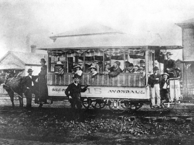 A mule-drawn street car on First Avenue North in downtown Birmingham in 1887. (From Encyclopedia of Alabama, courtesy of Birmingham Public Library Archives)