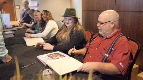 Mike Bolton, right, joins other contributors during a book signing Wednesday in Montgomery celebrating the 10-year anniversary of the Alabama Black Belt Adventures Association. (Dennis Washington / Alabama NewsCenter)
