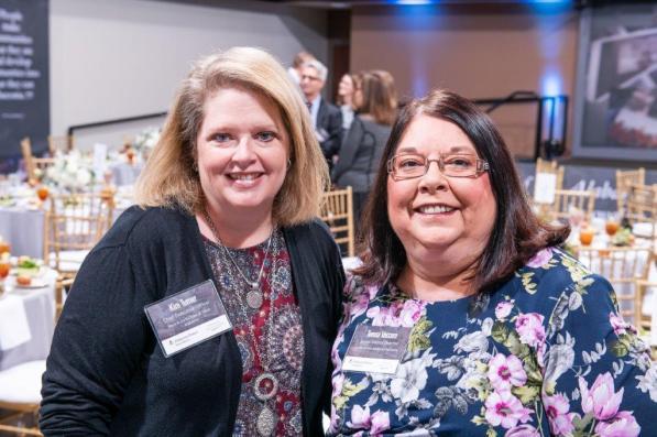 Attending the Alabama Power Foundation 30th Anniversary luncheon were Boys & Girls Clubs of West alabama CEO Kim Turner, left, and Junior Achievement of Alabama Senior District Director Teresa Vaccaro. (Nik Layman / Alabama NewsCenter)