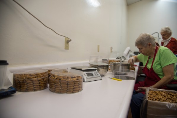 """The """"nut ladies"""" at Superior Pecans in Eufaula ensure the nuts and candies are perfect when they go out to customers. (Brittany Dunn / Alabama NewsCenter)"""