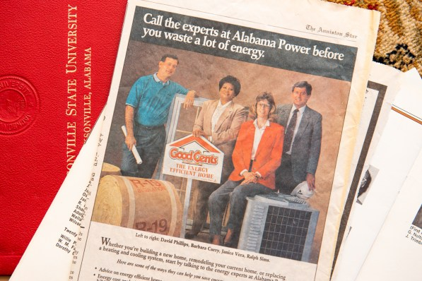Marketing employee Curry-Story (second, left) appeared in a newspaper ad for Alabama Power. (Nik Layman/Alabama NewsCenter)